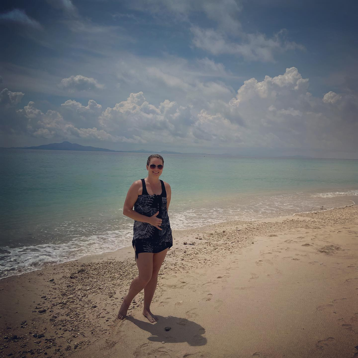 Photo of the author on the beach in Thailand